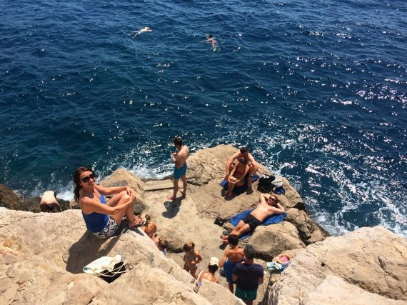 Soaking up the sun in Dubrovnik, Croatia. That's me closest to the camera, and my brother-in-law is below me on his back. We jumped from the rocks and the water was real warm and incredibly salty.